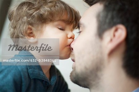 Toddler boy kissing father's nose Stock Photo - Premium Royalty-Free, Image code: 632-03848361