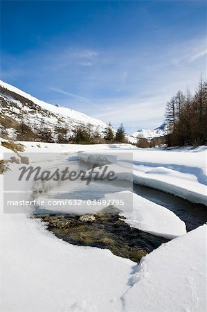 Ice floes floating on river in snowy landscape Stock Photo - Premium Royalty-Free, Image code: 632-03897795