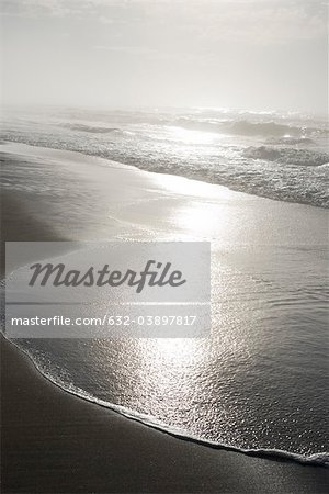 Surf lapping beach Stock Photo - Premium Royalty-Free, Image code: 632-03897817