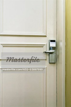 Hotel room door with electronic door lock, full frame Stock Photo - Premium Royalty-Free, Image code: 632-03897995