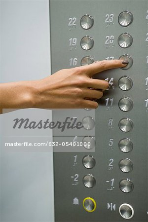 Woman's hand pressing 17 floor button Stock Photo - Premium Royalty-Free, Image code: 632-05401000