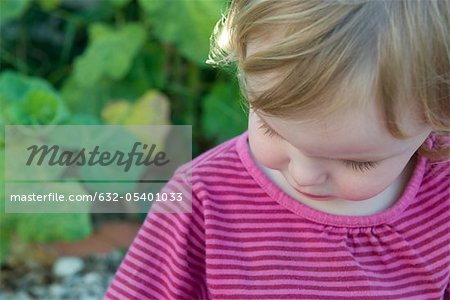 Toddler girl looking down Stock Photo - Premium Royalty-Free, Image code: 632-05401033