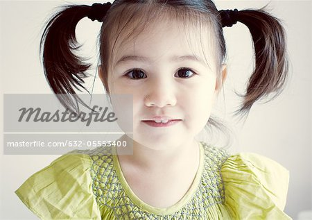 Little girl with pigtails, portrait Stock Photo - Premium Royalty-Free, Image code: 632-05553400