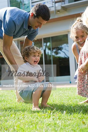 Family having fun together outdoors Stock Photo - Premium Royalty-Free, Image code: 632-05553530