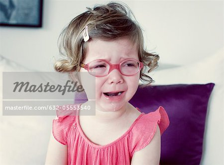 Little girl crying Stock Photo - Premium Royalty-Free, Image code: 632-05553540