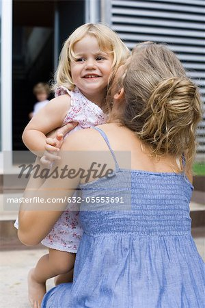 Mother embracing young daughter Stock Photo - Premium Royalty-Free, Image code: 632-05553691