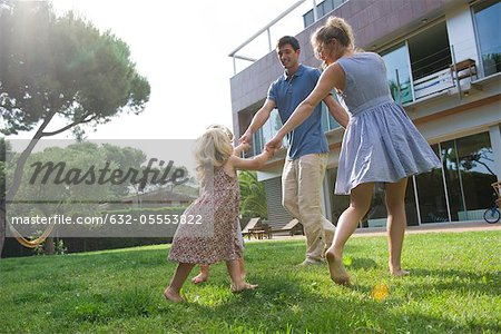 Family playing ring-around-the-rosy outdoors Stock Photo - Premium Royalty-Free, Image code: 632-05553822