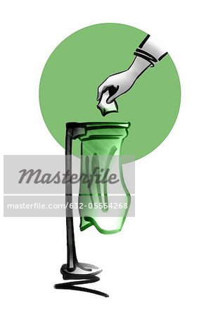 Hand throwing trash away in garbage bag Stock Photo - Premium Royalty-Free, Image code: 632-05554268