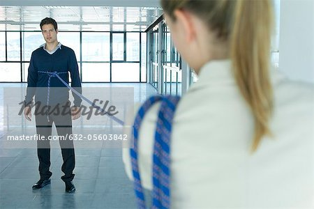 Businessman bound in rope Stock Photo - Premium Royalty-Free, Image code: 632-05603842
