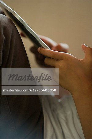 Child using digital tablet, cropped Stock Photo - Premium Royalty-Free, Image code: 632-05603858