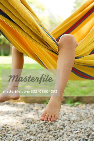 Child's legs dangling from hammock Stock Photo - Premium Royalty-Free, Image code: 632-05604393
