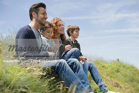 Parents with young boys sitting on meadow Stock Photo - Premium Royalty-Free, Image code: 632-05604604