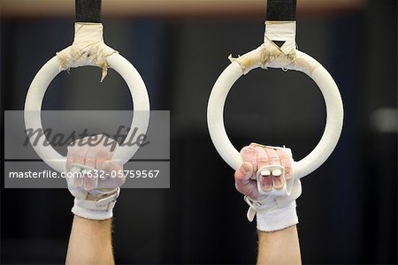 Gymnast's hands gripping the rings, cropped Stock Photo - Premium Royalty-Free, Image code: 632-05759567