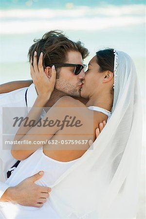 Bride and groom kissing at the beach Stock Photo - Premium Royalty-Free, Image code: 632-05759637