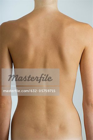 Woman's naked back, mid section Stock Photo - Premium Royalty-Free, Image code: 632-05759715