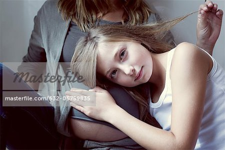Girl listening to mother's abdomen Stock Photo - Premium Royalty-Free, Image code: 632-05759835