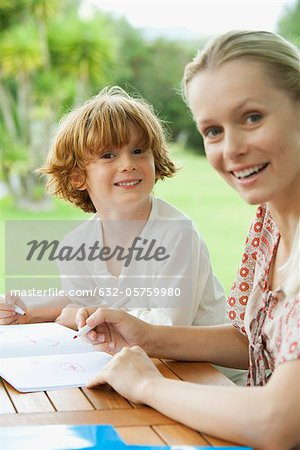 Mother and son coloring together Stock Photo - Premium Royalty-Free, Image code: 632-05759980