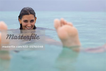 Woman floating in water, portrait Stock Photo - Premium Royalty-Free, Image code: 632-05760048