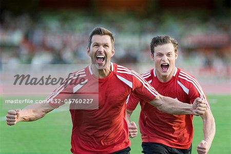 Soccer players shouting in victory Stock Photo - Premium Royalty-Free, Image code: 632-05760227