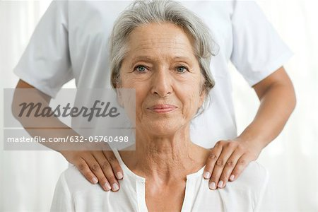 Senior woman getting a shoulder massage Stock Photo - Premium Royalty-Free, Image code: 632-05760498