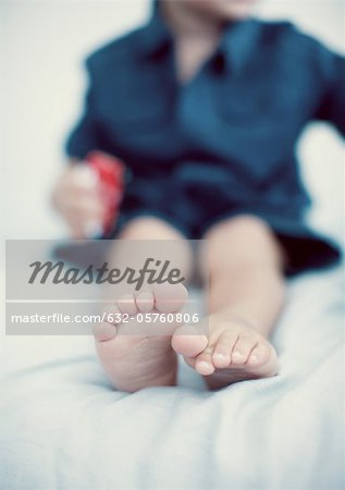 Feet of little boy low section Stock Photo - Premium Royalty-Free, Image code: 632-05760806