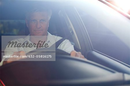 Man driving car, portrait Stock Photo - Premium Royalty-Free, Image code: 632-05816175