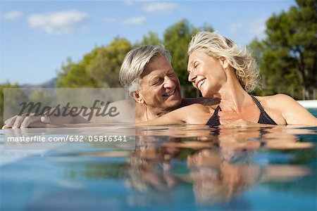 Mature couple relaxing together in pool Stock Photo - Premium Royalty-Free, Image code: 632-05816341