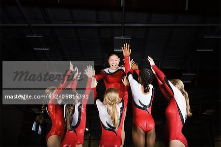 Team of female gymnasts celebrating victory together Stock Photo - Premium Royalty-Free, Image code: 632-05816391