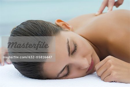 Young woman receiving massage, cropped Stock Photo - Premium Royalty-Free, Image code: 632-05816447
