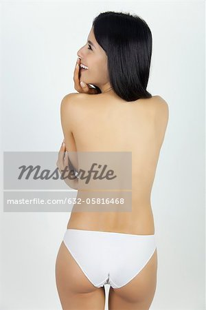 Woman standing in underwear, rear view Stock Photo - Premium Royalty-Free, Image code: 632-05816468