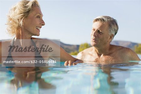 Retired couple soaking in pool Stock Photo - Premium Royalty-Free, Image code: 632-05816481
