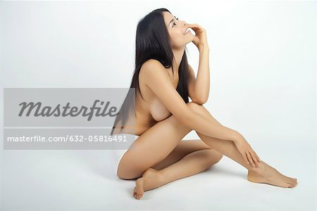 Woman sitting in underwear, daydreaming Stock Photo - Premium Royalty-Free, Image code: 632-05816491