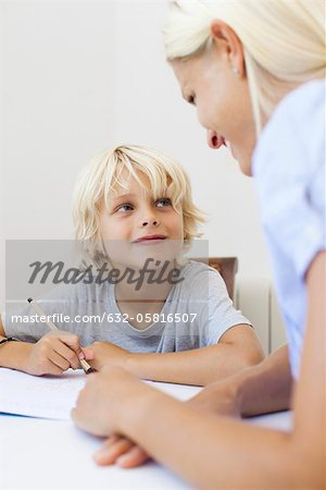Mother helping son with homework Stock Photo - Premium Royalty-Free, Image code: 632-05816507