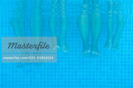Family soaking feet in pool, underwater view Stock Photo - Premium Royalty-Free, Image code: 632-05816524