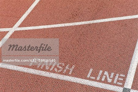 Finishing line of running track Stock Photo - Premium Royalty-Free, Image code: 632-05816540
