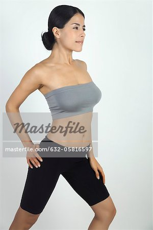 Woman stretching Stock Photo - Premium Royalty-Free, Image code: 632-05816597