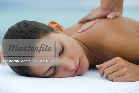 Young woman receiving back massage, cropped Stock Photo - Premium Royalty-Free, Image code: 632-05816618