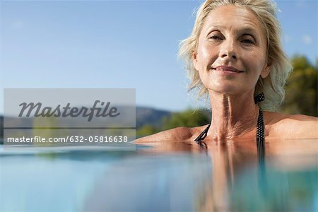 Mature woman relaxing in pool, portrait Stock Photo - Premium Royalty-Free, Image code: 632-05816638