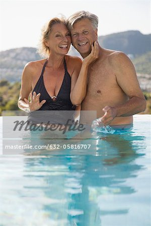 Mature couple relaxing together in pool Stock Photo - Premium Royalty-Free, Image code: 632-05816707