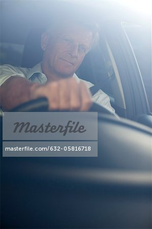 Man driving car, portrait Stock Photo - Premium Royalty-Free, Image code: 632-05816718