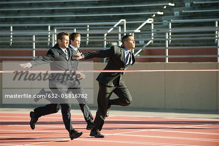 Businessmen approaching finish line in race Stock Photo - Premium Royalty-Free, Image code: 632-05816782