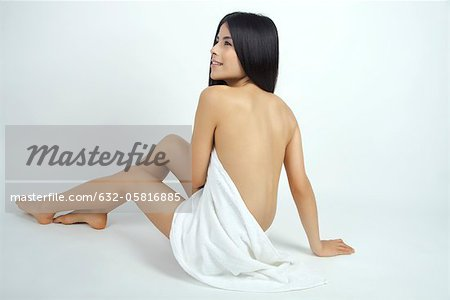 Nude woman partially covered with towel, rear view Stock Photo - Premium Royalty-Free, Image code: 632-05816885