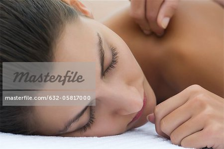 Young woman receiving massage, close-up Stock Photo - Premium Royalty-Free, Image code: 632-05817000