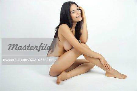 Woman sitting in underwear, full length portrait Stock Photo - Premium Royalty-Free, Image code: 632-05817152