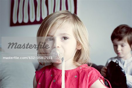Little girl sucking pacifier Stock Photo - Premium Royalty-Free, Image code: 632-05817153