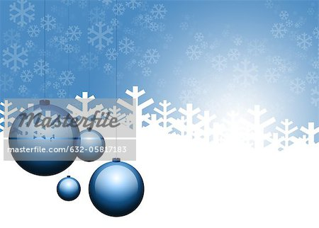 Christmas ornaments and snowflakes on blue background