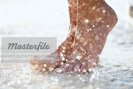 Feet under shower outdoors Stock Photo - Premium Royalty-Free, Image code: 632-05845055