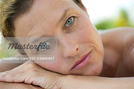 Mature woman resting head on arms, portrait Stock Photo - Premium Royalty-Free, Image code: 632-05845407