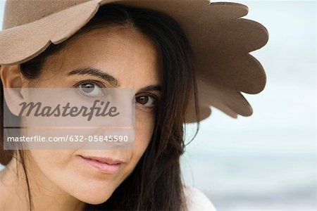 Woman wearing sun hat, portrait Stock Photo - Premium Royalty-Free, Image code: 632-05845590