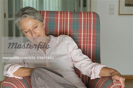 Senior woman napping in armchair Stock Photo - Premium Royalty-Free, Image code: 632-05845601